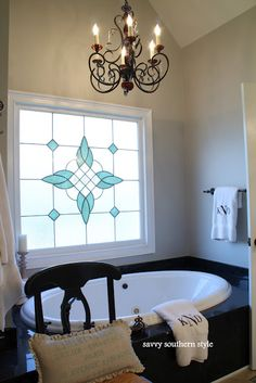 Stained glass over bathtub, something like this