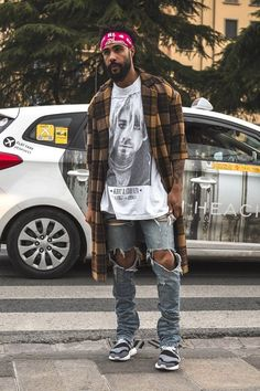 Jerry Lorenze wearing a grunge outfit featuring a Nirvana t-shirt in Florence during Pitti Uomo 90 in 2016.