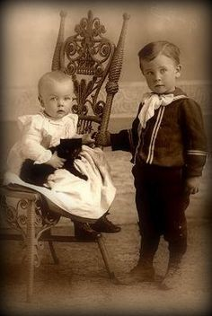 Sweet Victorian siblings and a their super cute black kitten c. 1900