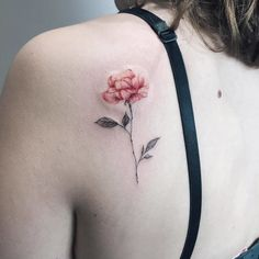 A pastel rose tattoo on the shoulderblade is STUNNING. See even more rose tattoo ideas for women right here.