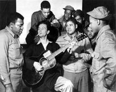 Woody Guthrie playing for African American GI's, 1943