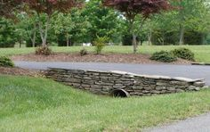 This shows landscape grading and drainage with a swale and pipe.