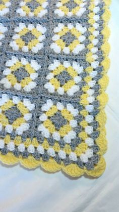 Handmade Granny Square Baby Blanket.  Color: Yellow, Silver Gray, and White.  Custom Made: Please allow 5 days from purchase for shipment of blanket.  Made from 100% soft acrylic yarn. Machine washable and dryable.  Measures 32 x 27 & is a great size for babies car seat, stroller, or crib.  Great as a shower gift or as a homecoming blanket for your new baby.  Comes from a non-smoking home.  Please contact me if you have any questions & check out my store for more handmade items.  Cust...