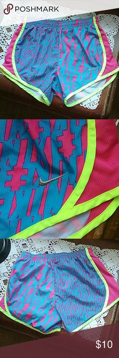 Nike running shorts Bright yellow piping with pink mesh sides, nike graphics in large print on one side,  small print on other. Super cute! Nike Bottoms Shorts