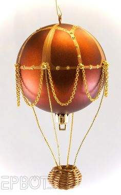 As I mentioned in my steampunk tree post, these hot air balloon ornaments have been our most time-consuming Christmas project. Lots of tr. Beaded Christmas Ornaments, Christmas Deco, Christmas Projects, Handmade Christmas, Balloon Crafts, Balloon Decorations, Balloon Ideas, Diy Hot Air Balloons, Mini Balloons