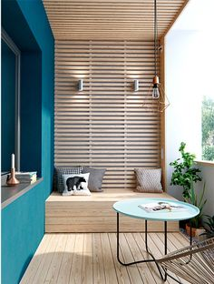 Modern light wood balcony with slat wall and ceiling and high-contrast blue accent wall Modern Balcony, Modern Patio, Modern Decor, Porch And Terrace, Outdoor Balcony, Wood Slat Wall, Wood Slats, Teal Walls, Wood Ceilings
