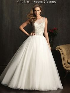 Gorgeous English Net and Tulle Embellished Ball Gown with Sheer Illusion Neckline Over Sweetheart Neckline, Illusion Tank Straps, Crystal Beaded Clear Stone and Pearl Bodice, Waist, Full Ball Gown Skirt, Chapel Train, V-Back with Covered Button Close.