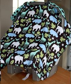 Homemade car seat cover.  This pattern is so simple, and I love how it can be tailored to basically any kind of carrier and fabric.