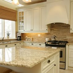 I love the caramel tones of the backsplash and picked up in the marble-English Country Decorating Style Design Ideas, Pictures, Remodel, and Decor - page 61