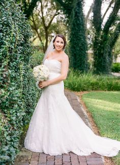Bridal Wedding Day Portrait in Strapless Wedding Gown with Veil and White Rose Bouquet