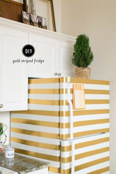 DIY Striped Fridge: http://www.stylemepretty.com/living/2015/01/30/diy-gold-striped-fridge/ | Photography: Ruth Eileen - http://rutheileenphotography.com/
