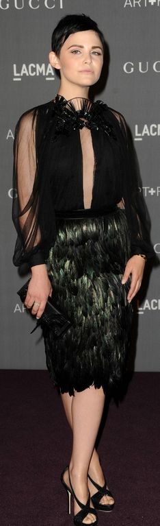 Who made Ginnifer Goodwin's black plunging top, feather skirt, sandals, and clutch handbag that she wore in Los Angeles on October 27, 2012? Dress, shoes and purse – Gucci