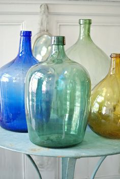 colored glass bottles, lammie verkoopt by wood & wool stool Colored Glass Bottles, Old Glass Bottles, Antique Bottles, Vintage Bottles, Bottle Vase, Bottles And Jars, Antique Glass, Perfume Bottles, Coloured Glass
