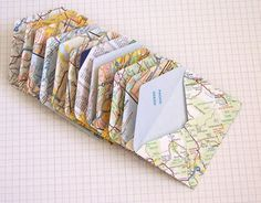 Map Mini-Envelope: Make mini envelopes out of maps to store things like favors or after-dinner mints at a wedding. You can also use it to wrap a trinket as a gift to a friend or to place under a pillow when you're playing tooth fairy. Mini Envelopes, Handmade Envelopes, Wedding Envelopes, Wedding Invitations, Popsugar, Map Globe, Diy Papier, Old Maps, Making Ideas