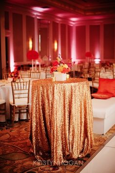 Select glitter linens. Not the whole venue but very cool as a standing table while people mingle with drinks. Love the pink lit walls.