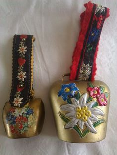 """Here are the bells I have.  The """"pulls"""" are what really made me think they were Scandinavian.  They are made of felt and are quite decorative.  The bigger bell is maybe 3 inches tall.  The design is embossed on it and then was painted.  It's definitely newer than the smaller one.  That one is maybe 1 1/2 inches tall and appears to have hammer marks so I'm guessing it is handmade. The larger one is brass.  The smaller one looks like it could be a brass/copper mix. The design on the smaller…"""