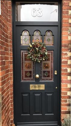 An inspirational image from Farrow and Ball. Railings is a great backdrop for Christmas decorations! Rustic Front Door Decor, Leaded Glass Door, Terrace House Exterior, Victorian Front Doors, Painted Front Doors, Cottage Front Doors, Farrow Ball, Hallway Decorating, House Front