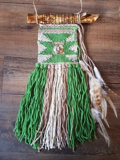 This is a hand woven wall hanging by MacuNana