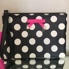 """NWT Betsey Johnson lrg/wristlet/clutch polka dot Gorgeous large wristlet carry/clutch measures at approximately 9"""" x 8 and she is by one half and of course expandable when filled,  polkadot exterior saffiano faux leather look exterior material, wristlet zip pull strap drop approximate 6.5 inches, top zip, iconic XOX Betsy heart stud hardware at the ends of the pink bow on the front side, Roomie interior, Arjun size measuring 9"""" x 7"""" x 1"""" strap drop a proxy 7 inches gold hardware, Picture for…"""