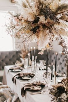 Okay, this cozy winter wedding inspiration has turned the heat up on neutrals! Wheat, rust and onyx never looked so good. And when you see the drippy chocolate naked cake, you will understand why. These two brides are bringing style to the table which ,speaking of, is decked out with an epic floral installation any couple would dream about. Head over to #ruffledblog to admire it all!