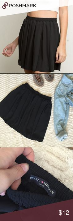 """Brandy Melville Sheer Black Short Skirt Brandy Melville • One size (best fits sizes XS, S, or M) • Entirely elastic waistband • Measurements: Waist: 24"""" circumference. Length: 15.25"""". • Made in the USA • Slightly sheer, but not completely see through. Suitable to wear without a slip • Made of rayon • Gathered • Light and flowy material • In absolutely perfect condition. No flaws whatsoever Brandy Melville Skirts"""