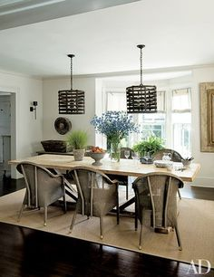 A Hamptons Dining Room With Wicker Chairs And Unique Ceiling Fixtures Archdigest Contemporary