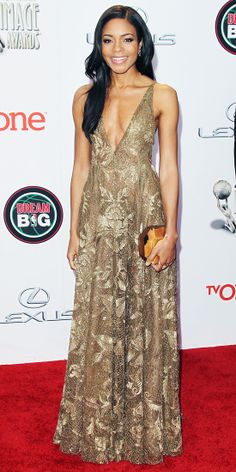 Naomie Harris went for a gilded effect, which she achieved in a gold-leaf lace plunging Valentino gown paired with a metallic Rauwolf clutch...