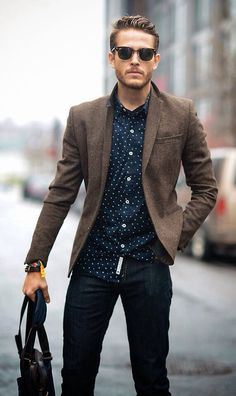 Patterned shirt and a slim brown blazer.