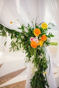 Beautiful garland with color flowers: http://www.stylemepretty.com/destination-weddings/2015/05/18/colorful-puerto-vallarta-destination-wedding/   Photography: Sarah McKenzie - http://www.sarahmckenziephoto.com/
