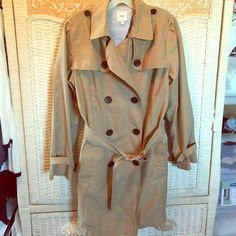 Gap trench coat w/ belt Gap trench coat with belt.  Includes belts around each cuff of sleeve. Soft cotton and nylon materials. Easy to wash. Open slit in back but threading never removed to open. Worn once. Great coat to protect your outfit from the storm! Missing button-tie design on top of each shoulder. GAP Jackets & Coats Trench Coats