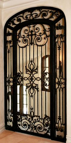 love this iron door w/ cross Old World, Mediterranean, Italian, Spanish & Tuscan Homes Design & Decor Gate Design, Door Design, House Design, Wrought Iron Decor, Wrought Iron Gates, Contemporary Bathroom Lighting, Contemporary Home Decor, Tuscan Design, Tuscan Style