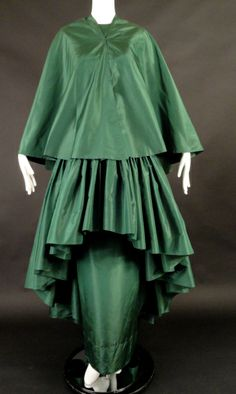 1970 Couture Madame Grés Silk Evening Gown  Cape. My opinion is the gown was a special request from a 1950s model pictured here. Matching full circle cape is slit up down the center so it wraps perfectly around the body. Front