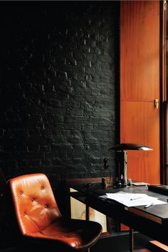 black painted brick office wall