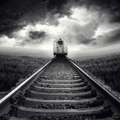 Fantastic Black and White Conversion with the railway lines, picking up the light and leading the eye towards the train which is on the top third line.