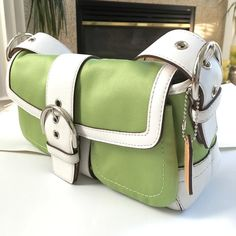 Coach spring shoulder bag New with tag. Authentic coach shoulder bag with two pocket front snap closure. Measurement:  12Wx7Hx4D perfect color for spring time, lime green and white. Coach Bags Shoulder Bags