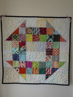 Scrappy Churn dash mini quilt made with Denyse Schmidt fabrics and low volume background to create a fun design by fabricandflowers. Charm Pack Quilts, Charm Quilt, Quilt Baby, Scrappy Quilts, Mini Quilts, Patchwork Quilting, Churn Dash Quilt, String Quilts, Miniature Quilts