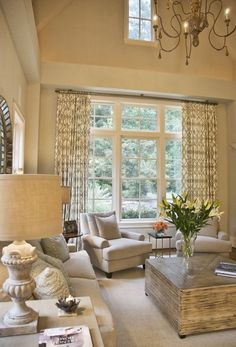 For formal living room - Patterned curtains, chandelier and wood coffee table