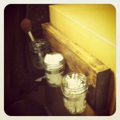 made by the hubby for the master bath :) #pallet #masonjars
