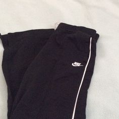 Nike sweatpants Black in color with two white lines on either side of leg. Has small side slit by each ankle. In excellent used condition. Open to all offers Nike Other