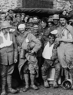 Allied wounded after a battle near Rheims, France, during World War I. Allied soldiers, many wearing slings or medical dressings, pose for the camera. Despite their injuries, most manage to appear cheerful. The British government and military commanders considered it important for morale in Britain that troops were seen to be remaining positive and determined