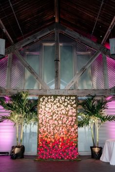 Amazing ombre flower wall- perfect for a cake backdrop, sweetheart table backdrop, or photo booth!