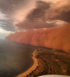 A massive dust storm barrels past Western Australia and over the Indian Ocean.