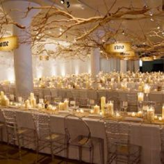 decor, gold weddings, reception ideas, tree branches, wedding table flowers, flower petal and candle tables, cream and gold table setting, winter weddings, lots of candles wedding