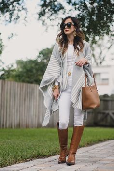 Woman wearing white jeans, white top, gray and white poncho, brown leather handbag and brown boots Brown Boots Outfit Winter, Jeans Outfit Winter, Winter Mode Outfits, Winter Fashion Outfits, Autumn Winter Fashion, Fall Outfits, Gray Jeans Outfit, Womens Brown Boots, Tan Boots Outfit