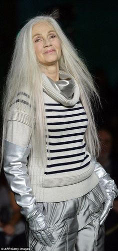 54b30c6ae9 Female models were styled in space-age silver to match their glamorous hair  styles at Jean Paul Gaultier Paris Fashion week show.