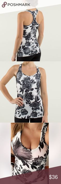 Lululemon 🍋 Cool Racerback Tank Lululemon Cool Racerback Tank in Excellent condition. Pattern is Brisk Bloom Black White . No stains, holes, rips or tears. Size 6 lululemon athletica Tops Tank Tops