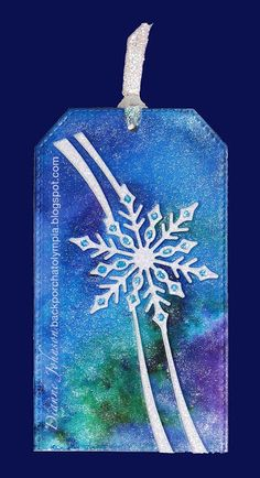 I love this Snowflake Ribbon die from Poppy. It looks great in a tag or a card. For these tags, I gathered up all of the watercolor paper t. Christmas Gift Tags, Christmas Items, Christmas Ornaments, Bee Gifts, Present Wrapping, Inspiration Wall, Felt Art, Tim Holtz, Snowflakes