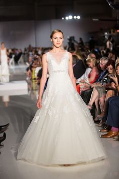 Juliet in the Enzoani Show in the OC this spring. Enzoani-Spring-2014-Wedding-Dresses-09