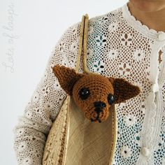 Just a Chihuahua's head. Use a safety pin to stuck it in your purse. Chihuahua head can also be pinned to a backpack