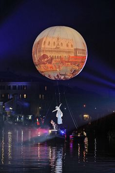 An actor performs along the Canaregio Canal for the opening of the Venice Carnival on January 23 2016 in Venice Italy The 2016 Carnival of Venice...